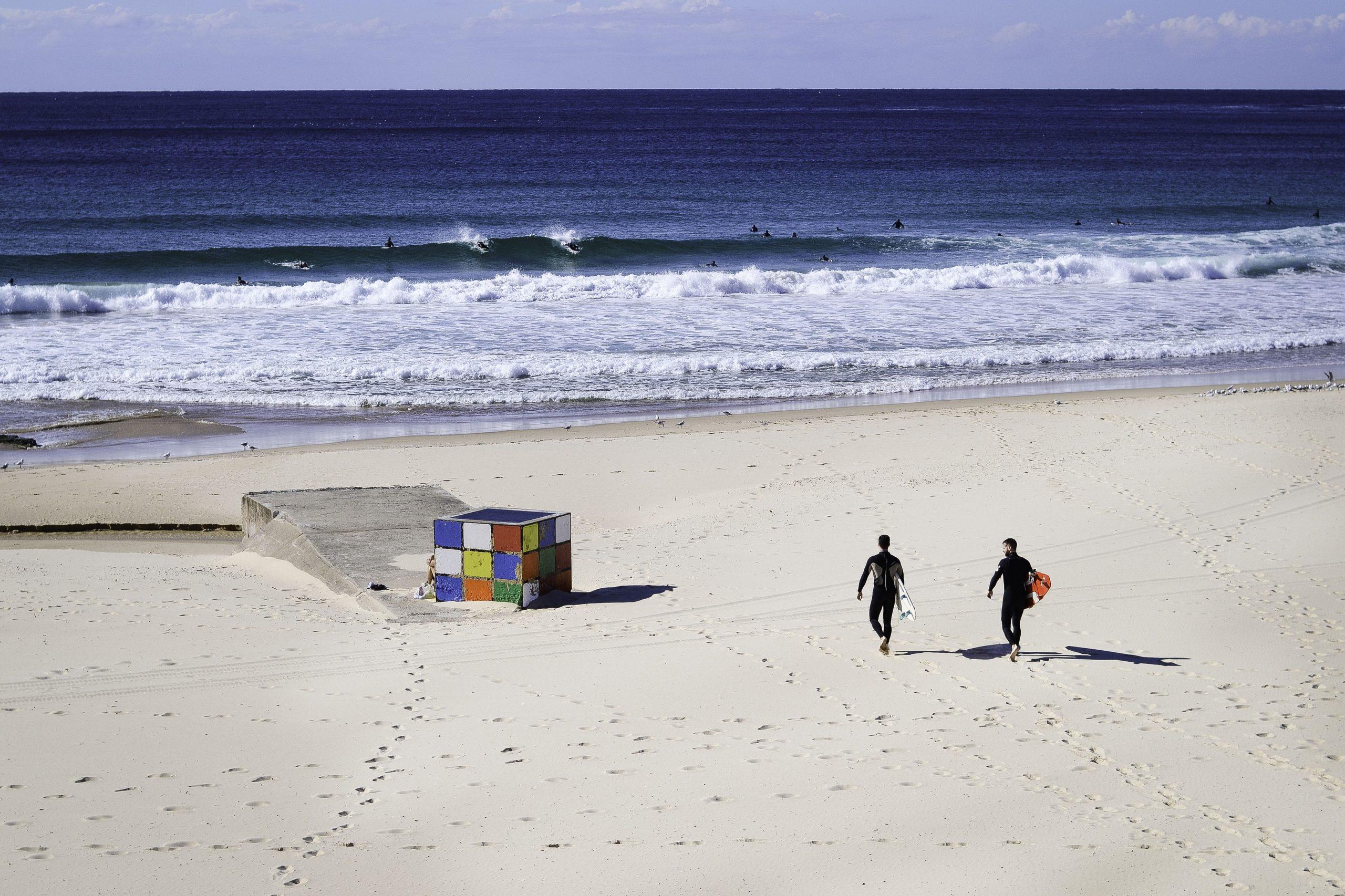 surfers walking to the ocean